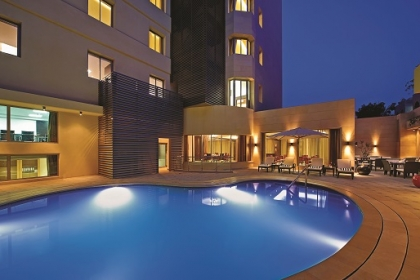 Swimming pool at Corp Amman Hotel