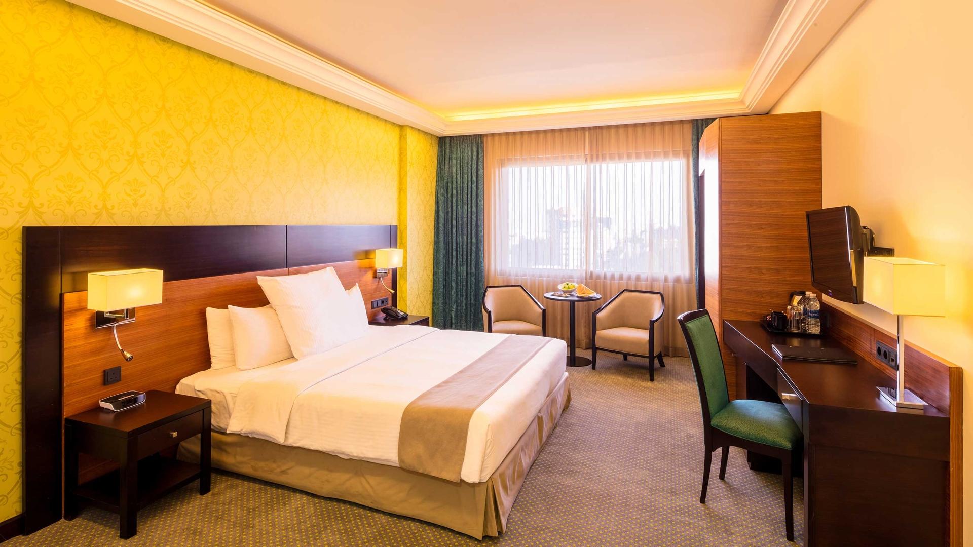 غرفة ديلوكس في فندق كورب عمان